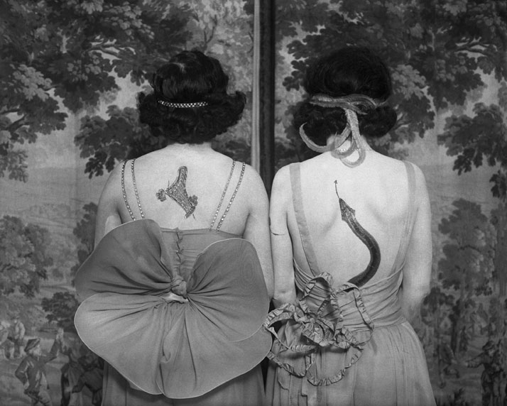Women wearing tattoos and costumes. Photographer: anonymous. © CORBIS  Bettmann.
